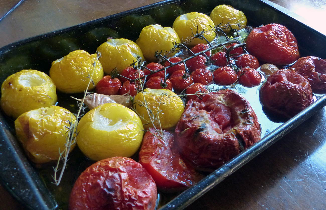 Oven roast tomatoes and serve as a side dish with fish and rice or any other grain.