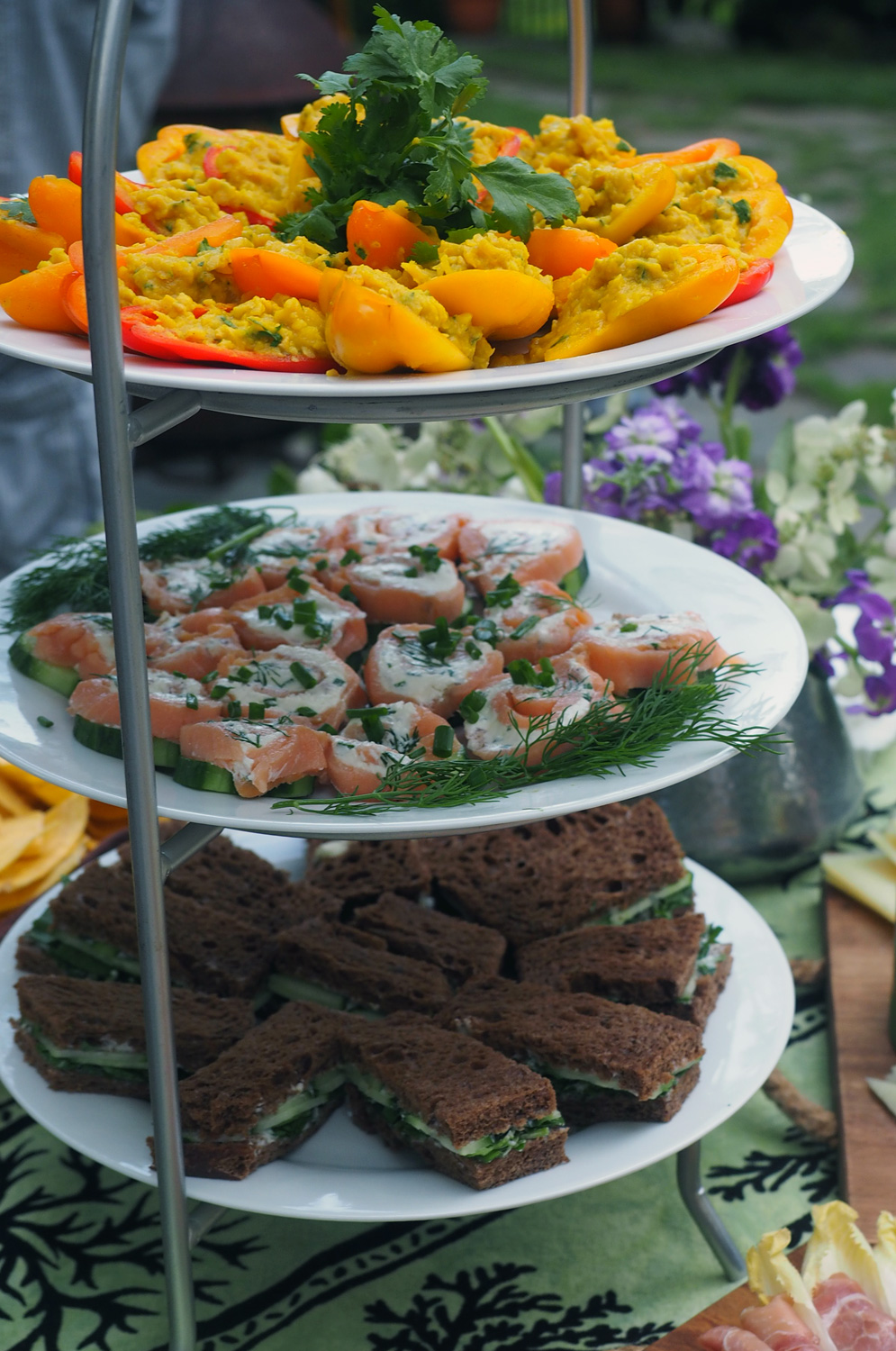 The tower of offerings. Chick Pea Mash,  Salmon Roll Cucumber Rounds  and  Watercress, Herb Butter Tea Sandwiches .