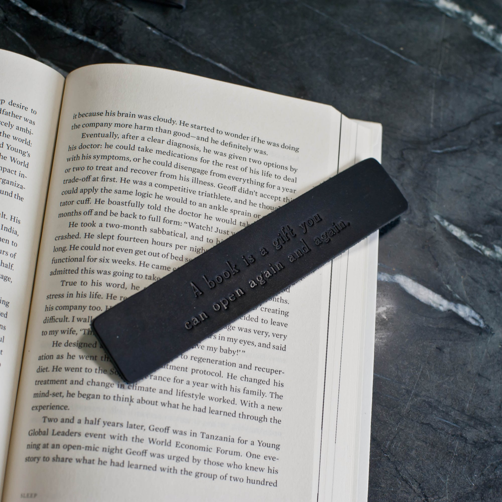 Mark your page with a personalized leather bookmark by  Ox & Pine . Make it a truly special gift by adding their name, graduation year, or favorite quote.