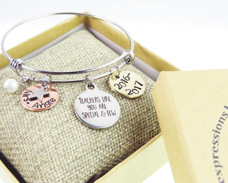 Some teachers make a difference beyond words. Show your appreciation with a customizable teacher bangle by  Expressions Bracelets .
