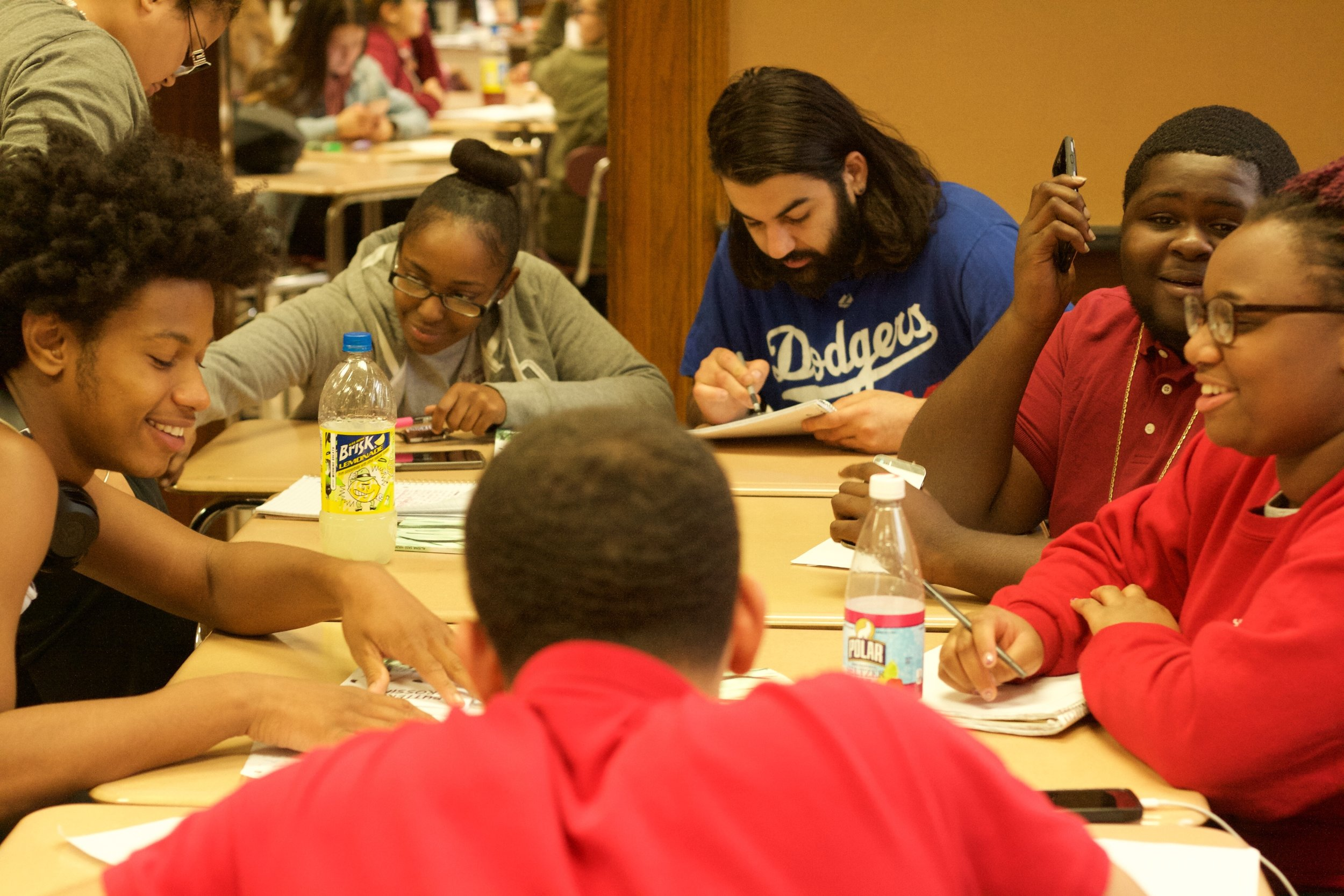 - Students from the high school of Commerce work in a poetry group.