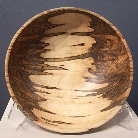 """Nice color and figure in this maple bowl.14"""" wide by 5"""" high  See more at Ariel Gallery (@ariel.gallery.avl) in downtown Asheville- 19 Biltmore Ave.  #maplebowl #turnedwood #woodworking #wooddecor #homedecor #artgallery #asheville #thingstodo #art #wooddesign #woodturning #arielgallery #biltmoreavenue #downtownasheville #mapleburl #maple #burl"""