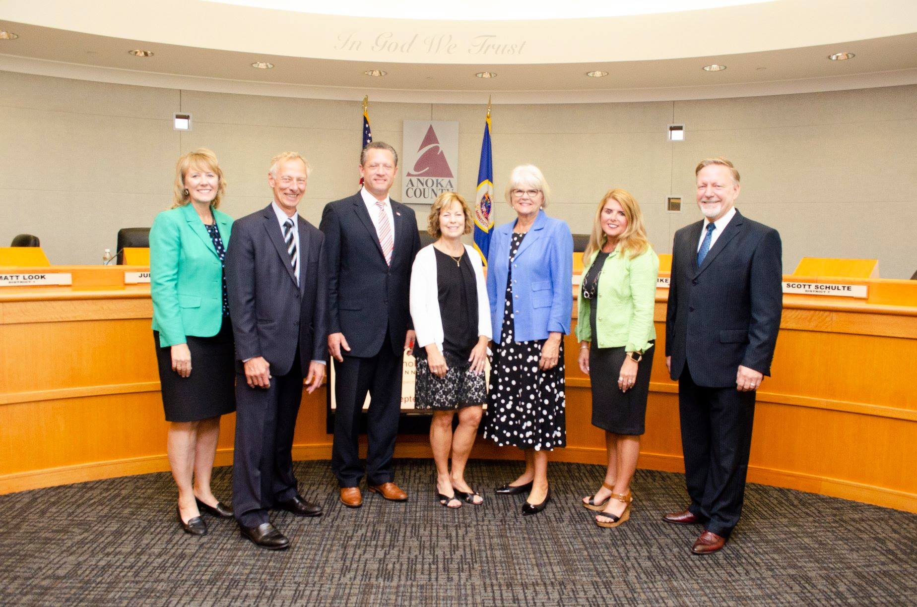 PICTURED: Commissioner Rhonda Sivarajah, Commissioner Jim Kordiak, Commissioner Matt Look, The Dwelling Place Executive Director Linda Wiza, Commissioner Robin West, Commissioner Julie Braastad, Commissioner Scott Schulte. Not pictured is Commissioner Mike Gamache.