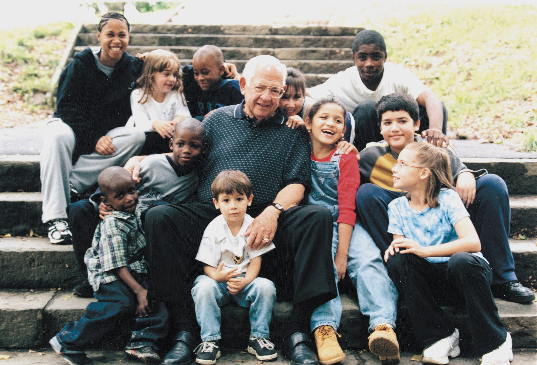 Dave Thomas poses in new york city with children in foster care