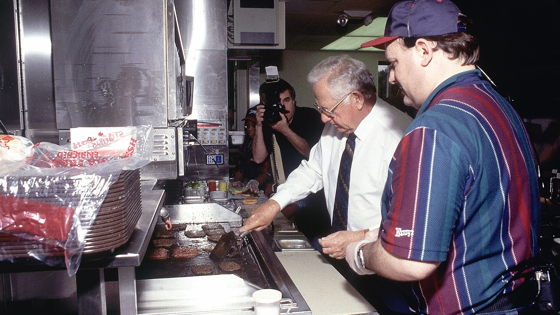 Dave serving up burgers in the Wendy's kitchen