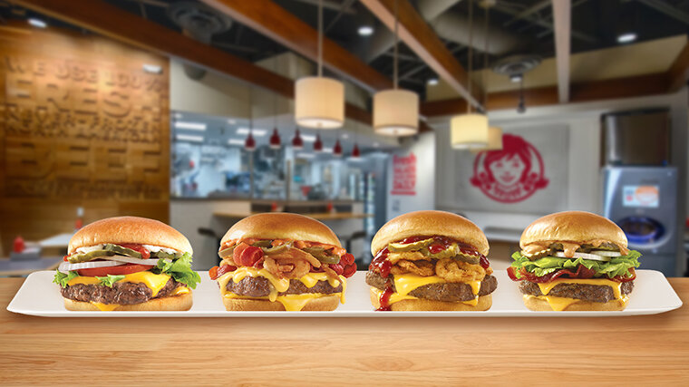 Celebrate National Cheeseburger Day with one of our delicious, mouth-watering sandwiches. Pictured from left to right, The Dave's Single, The Bacon Jalapeño Cheeseburger, The Barbecue Cheeseburger and The S'Awesome Bacon Cheeseburger.