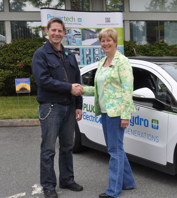 Left to Right: Sean Allan, Project Engineer from Powertech is welcomed to the Colwood SunFest Event by the Mayor of Colwood, Carol Hamilton.