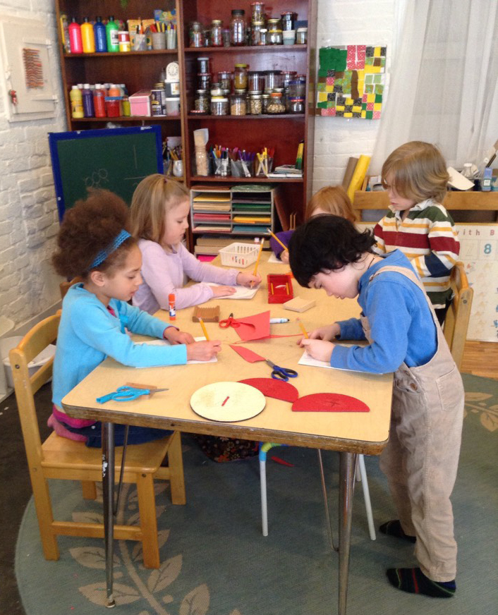 Kindergarten students work on their morning lesson.