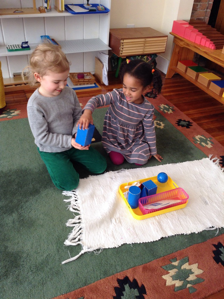 Two students share the geometric solids work.