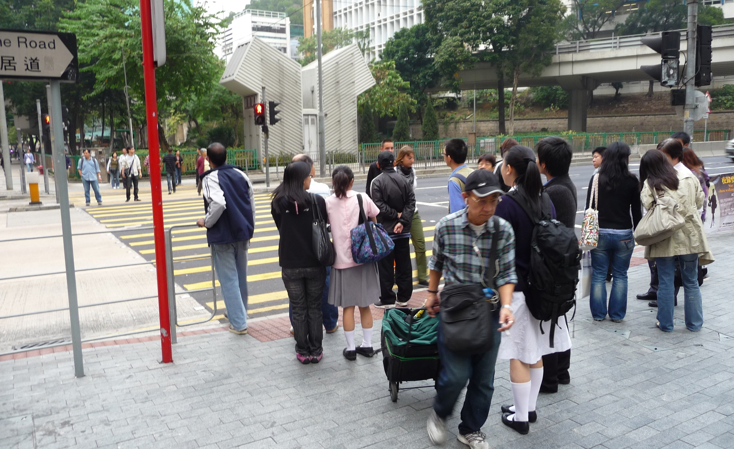 Which way is traffic coming from? It's Hong kong, which used to be British, so the cars are coming from your right. If this were Mainland China, they'd be coming from your left.