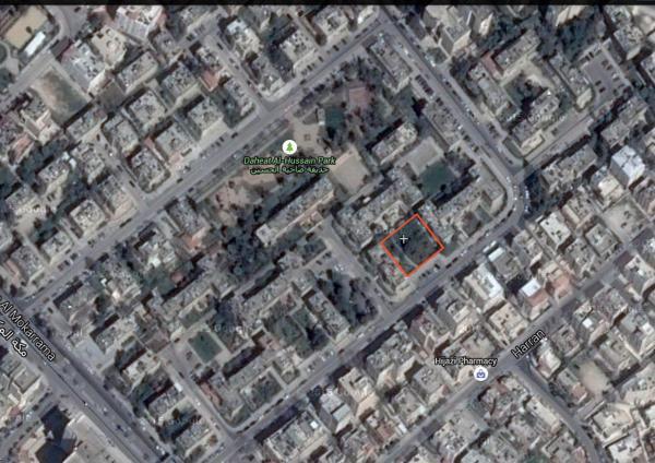 Aerial view showing the green pocket's location   لقطة جوية تبين موقع المساحة الخضراء