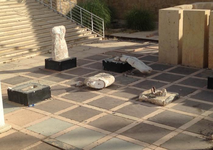 Closer view of some of the damaged sculptures   صورة مقربة تبين بعض المنحوتات المحطمة