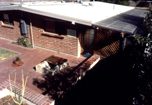 Figure 2: A view of the backyard of Casa del Agua that shows the concrete paving and extended  rooftop.
