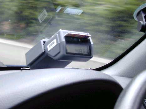 Figure 1: An electronic toll-road charging device placed on dashboards of motor vehicles in Singapore.