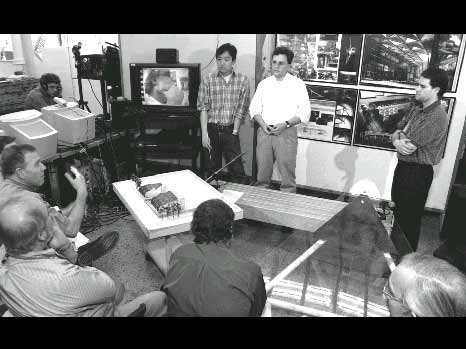 Figure 8: An MIT architectural design jury in which a remote juror (shown on the television screen) is participating through the aid of teleconferencing technologies.
