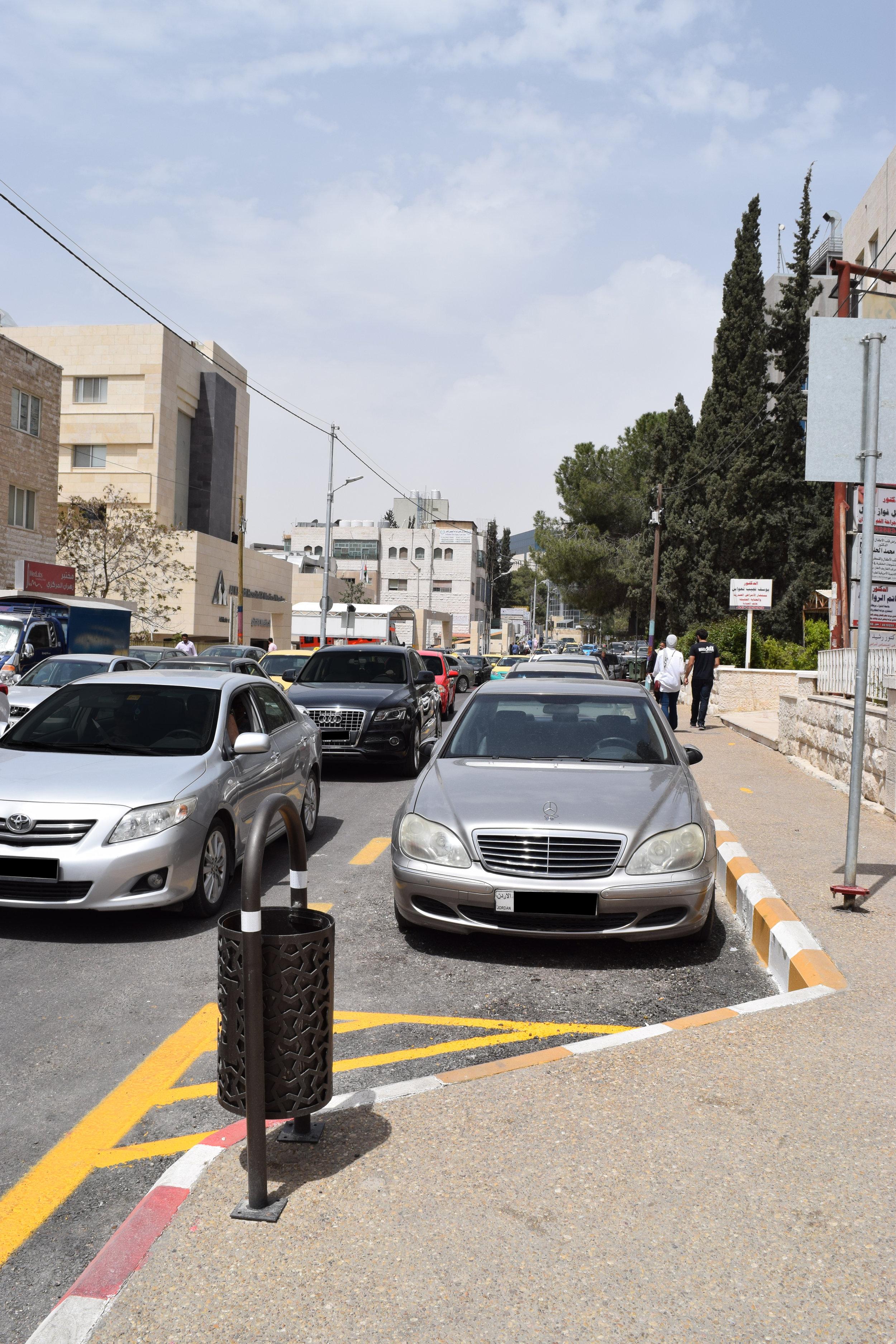 An off-set street-side parking area.