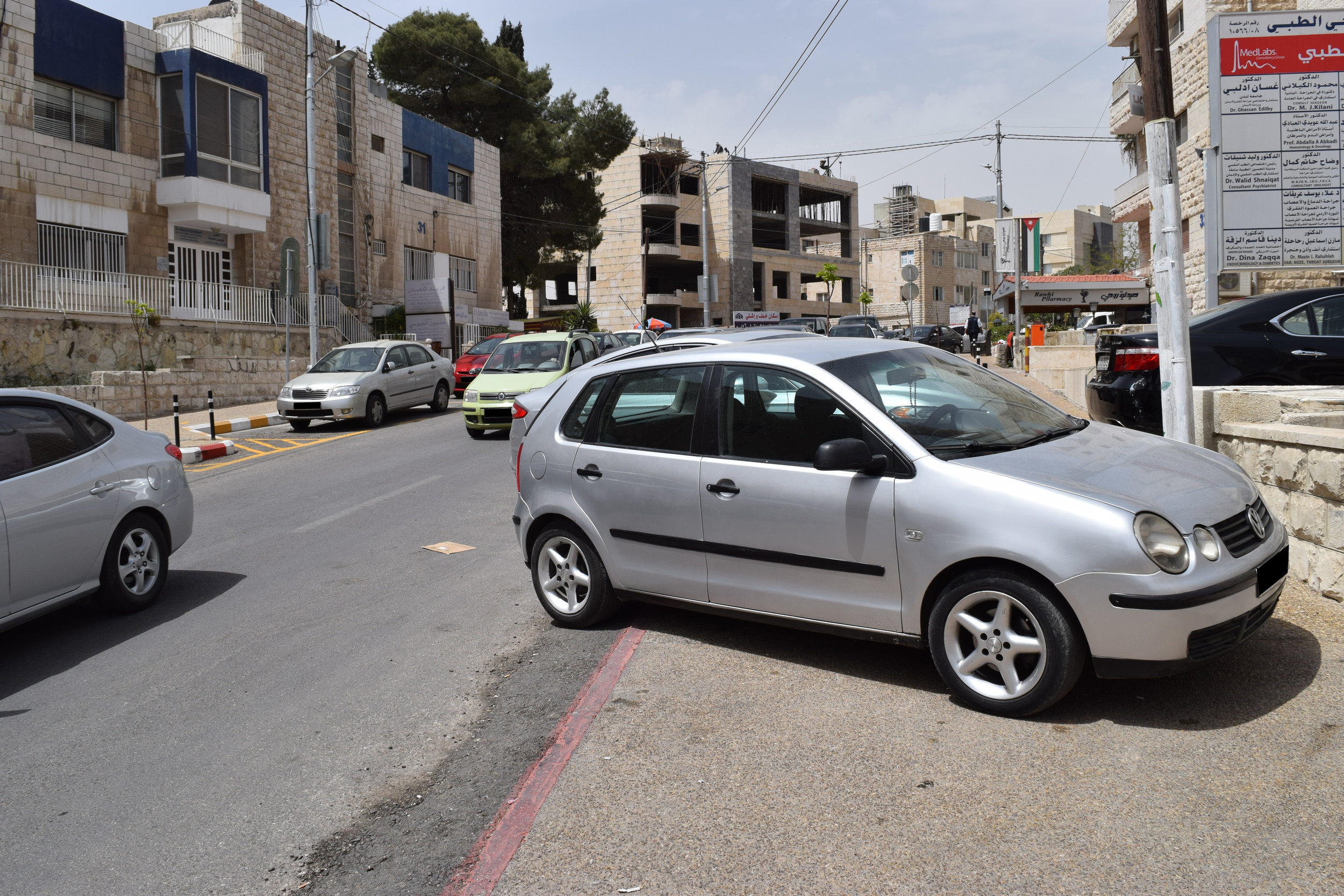 A car parked on the sidewalk.
