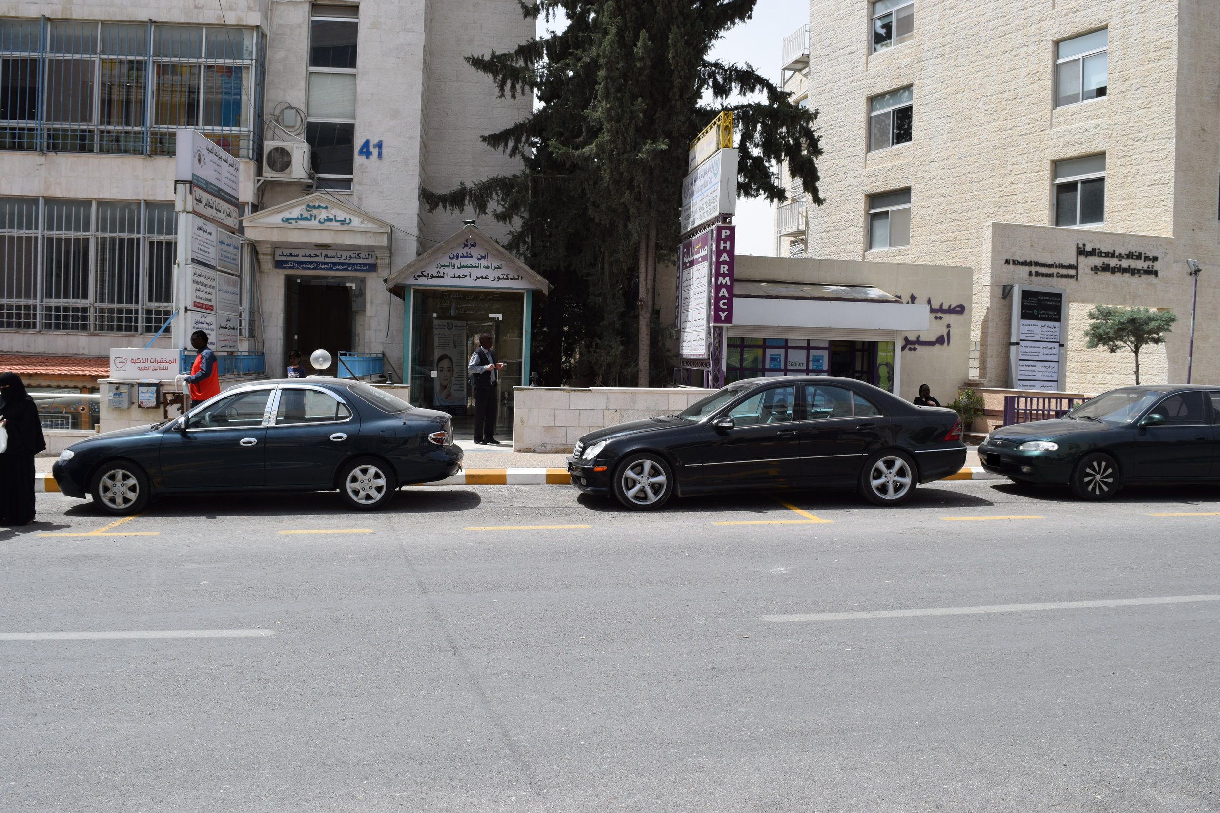 Cars parked across the designated parking lines