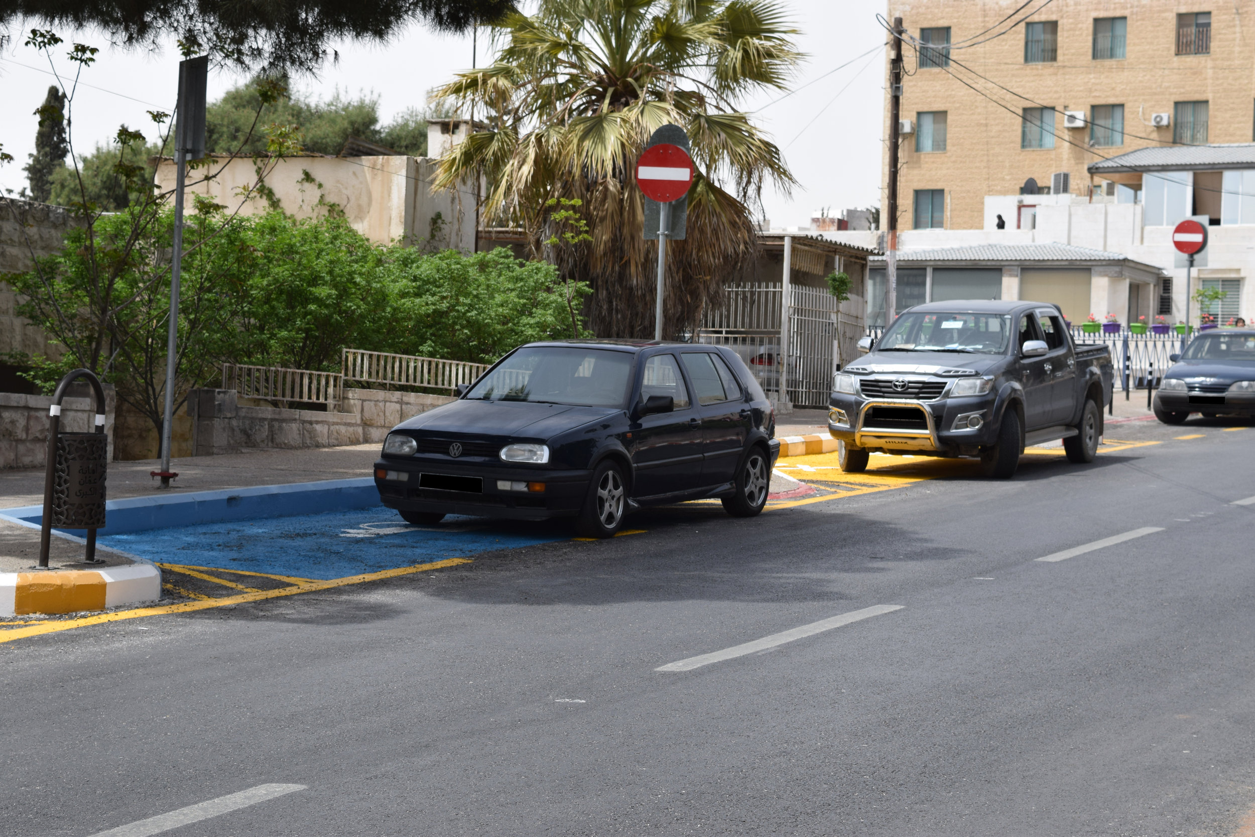 Cars illegally parked in the handicapped and taxi parking zones.
