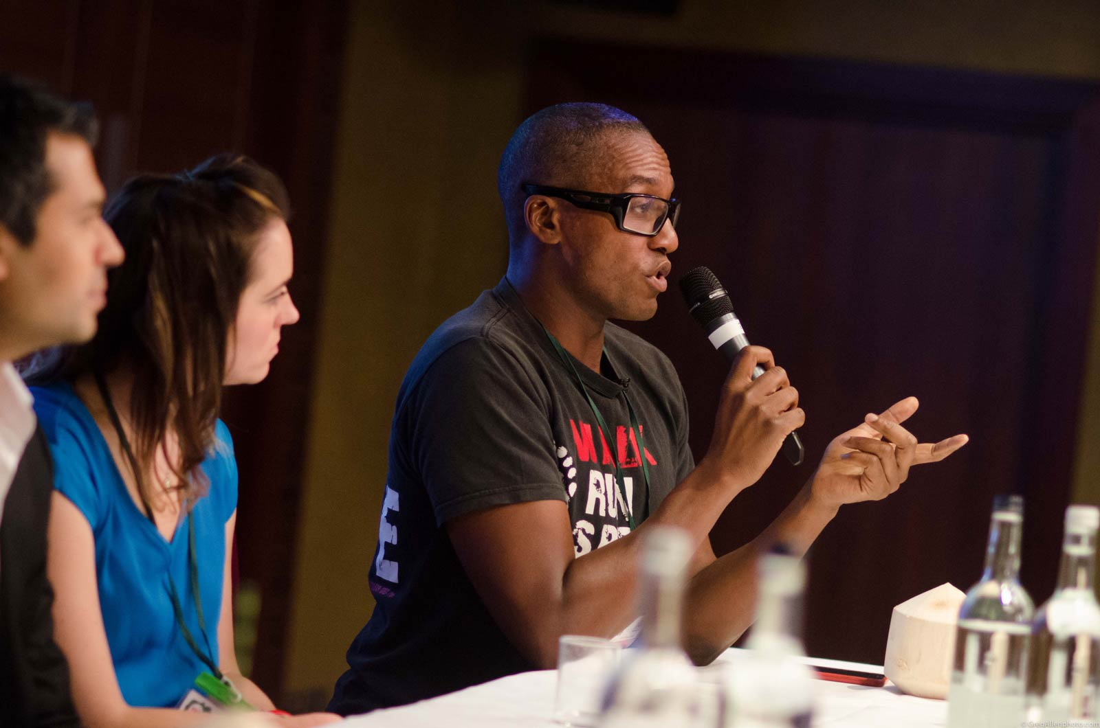 Darryl speaking on a panel about living a healthier lifestyle in London, England.