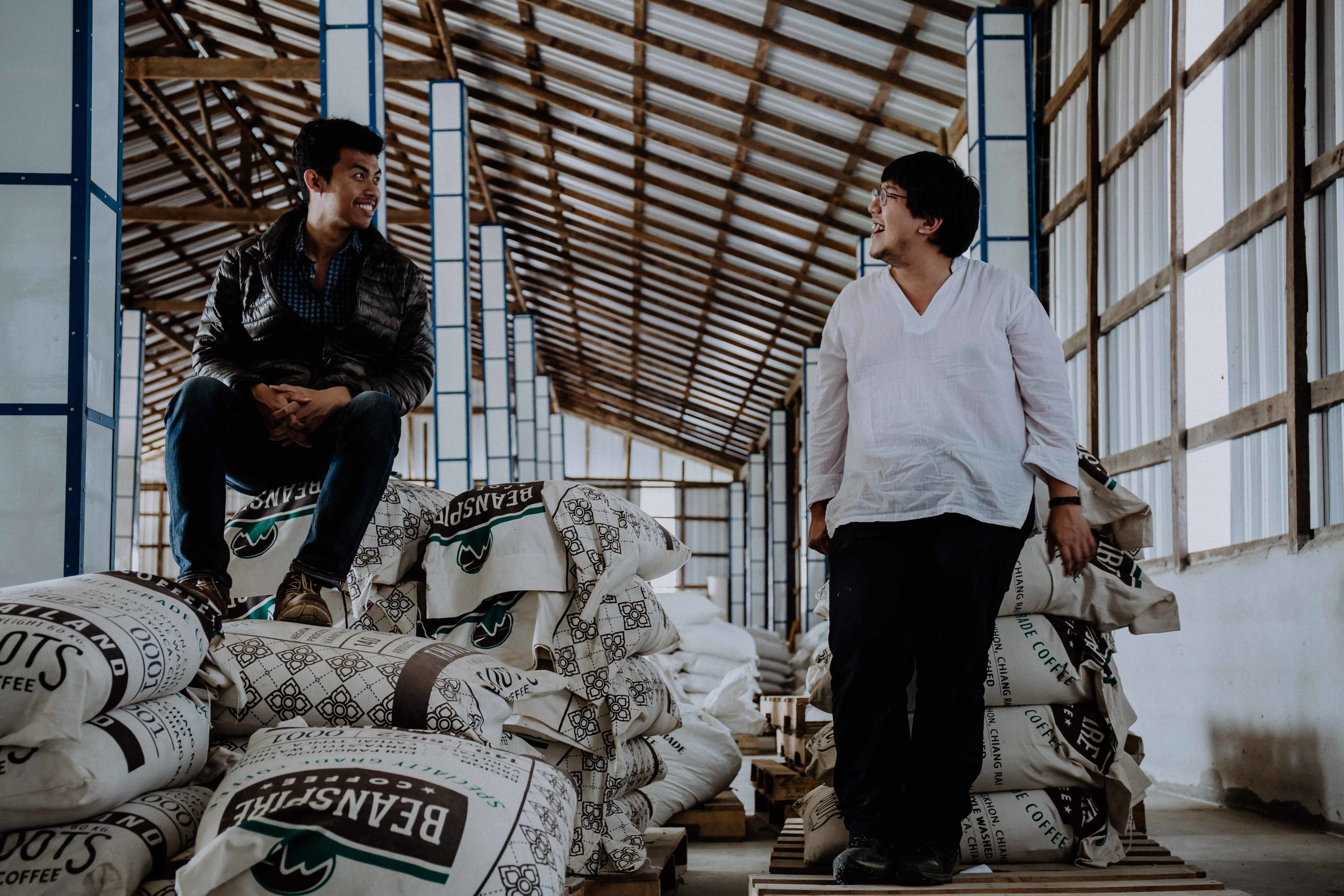 Fuadi and Korn, who is head roaster at Roots, together at the Beanspire dry mill
