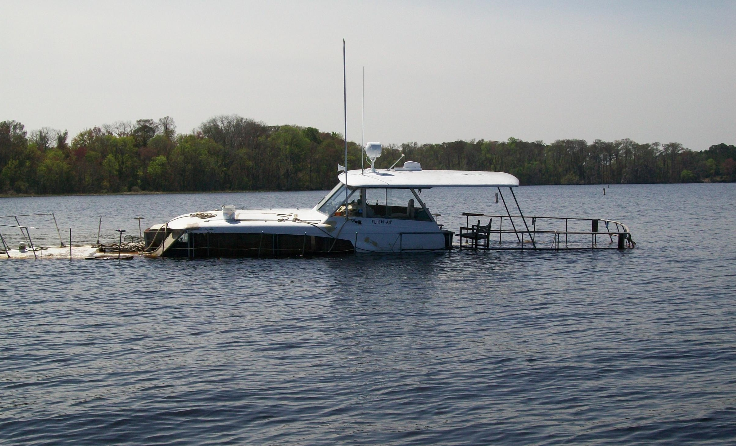 One of the derelict boats set to be pulled from the St. Johns River in Clay County Credit: Florida Fish and Wildlife Commission