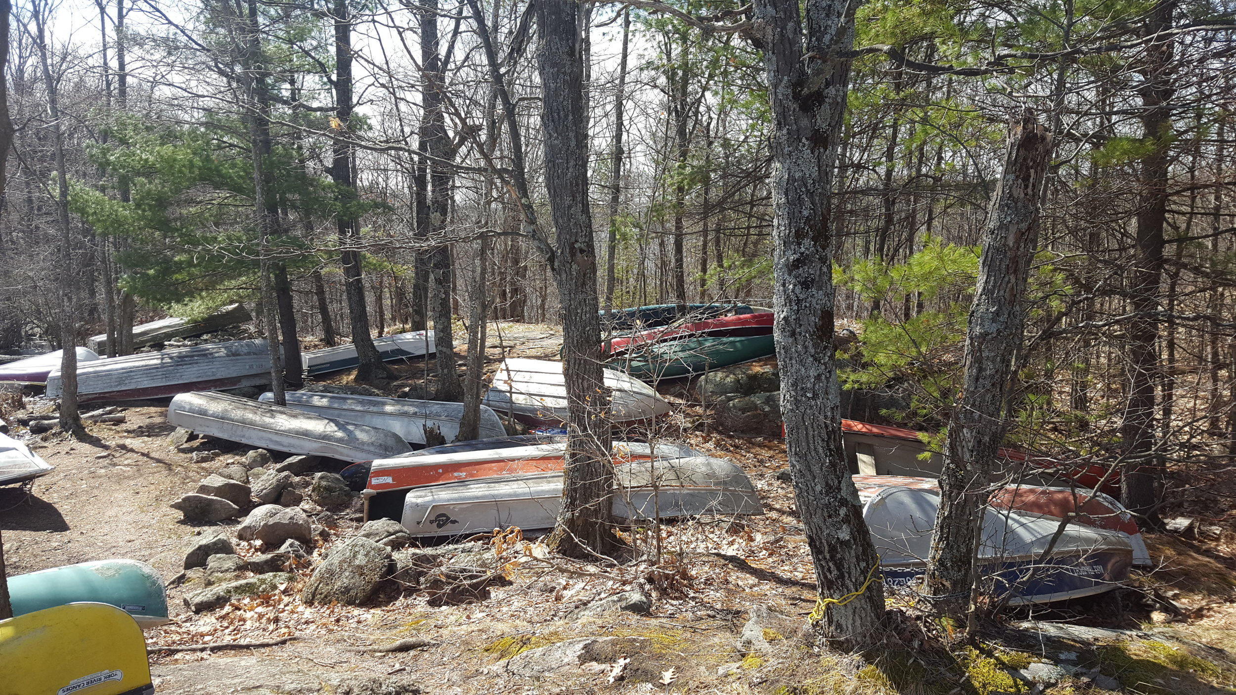 Canoes left at Rathbun Lake from cottagers on Anstruther Lake