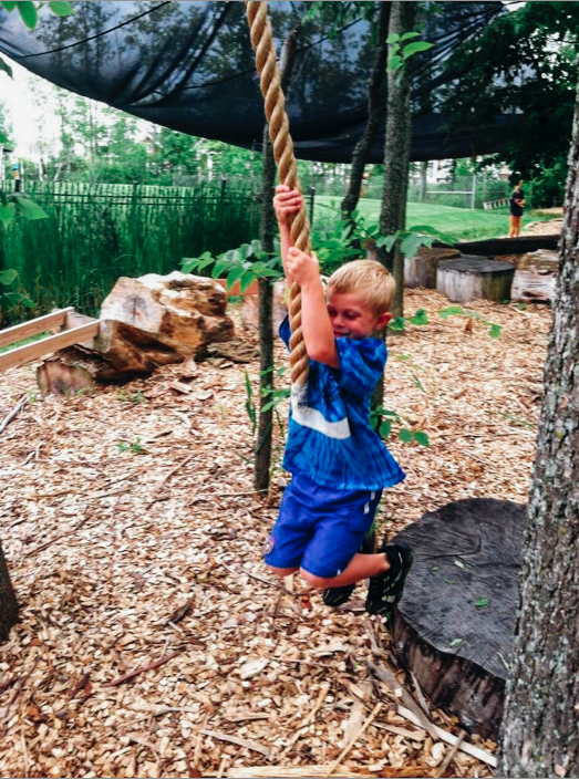 Swing on our rope course at adventure summer camp in rochester ny!