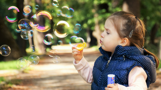 girl blowing bubbles.png
