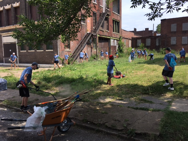 An AMP group from Texas works with residents to clean up a lot near Mission: St. Louis, 2017