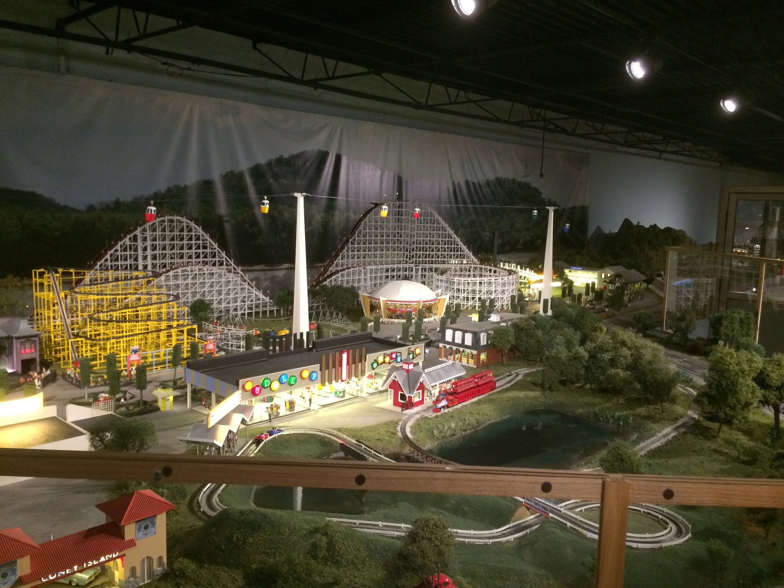 The Coney Island display is absolutely huge. The Shooting Star wooden roller coaster is just over 4 feet tall (almost 1.25 m) and 40 feet long (just over 12 m). Both the Shooting Star in the background and the yellow Wild Mouse model coasters are visible in this shot.