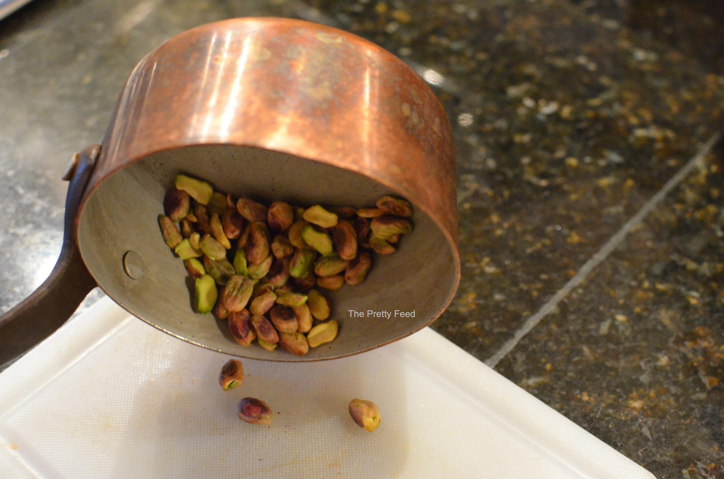 Roast the pistachios until golden brown