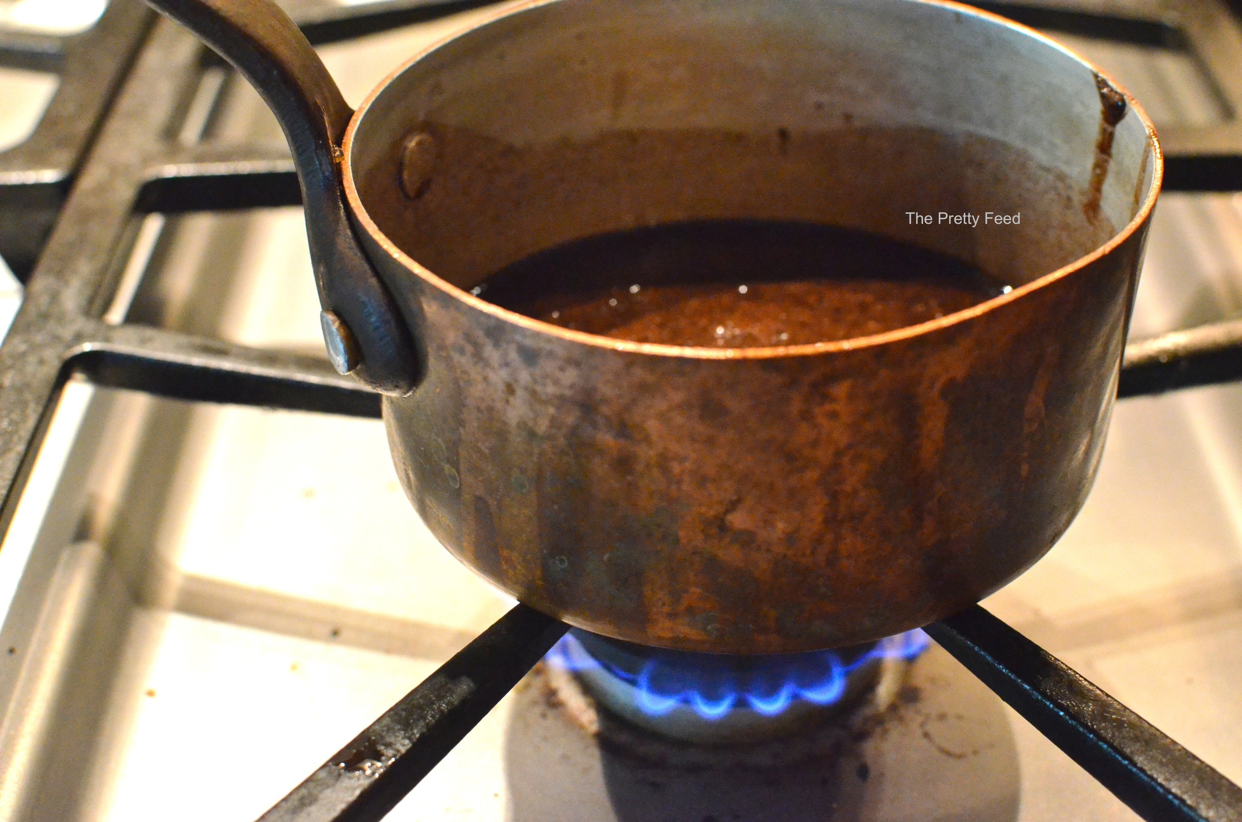 On low heat slowly mix ingredients together and bring to a boil. Then keep it warm until your banana ice cream is ready.