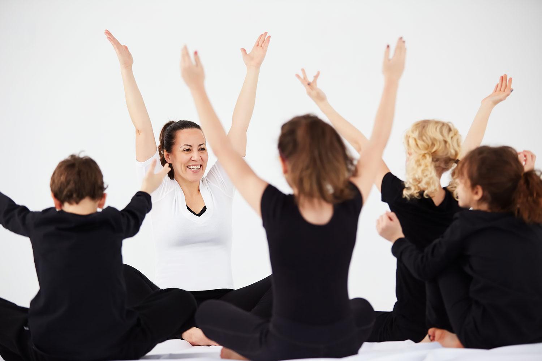 Maria Ferraro leads a kids' yoga class