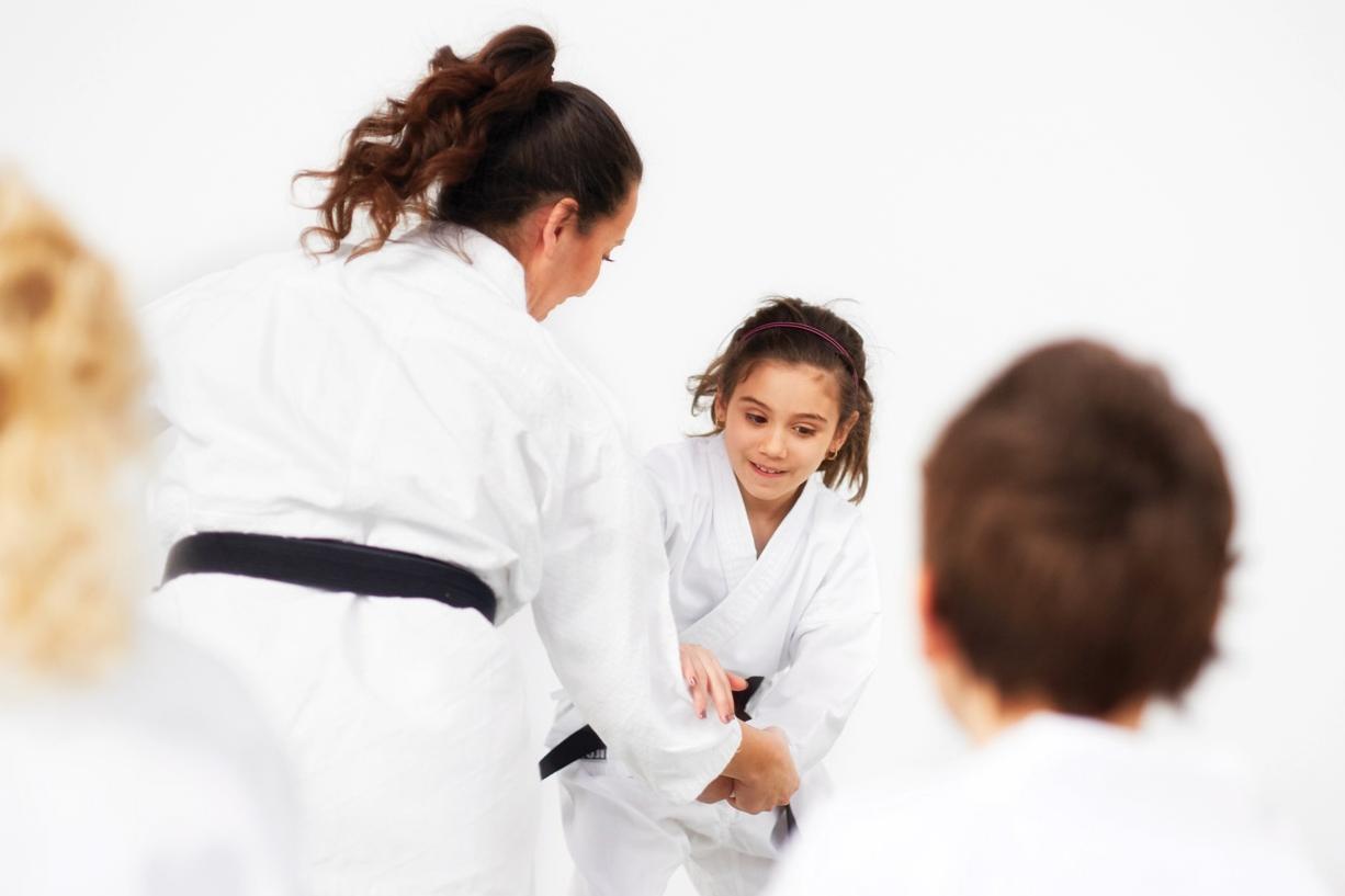 Four kids in the dojo