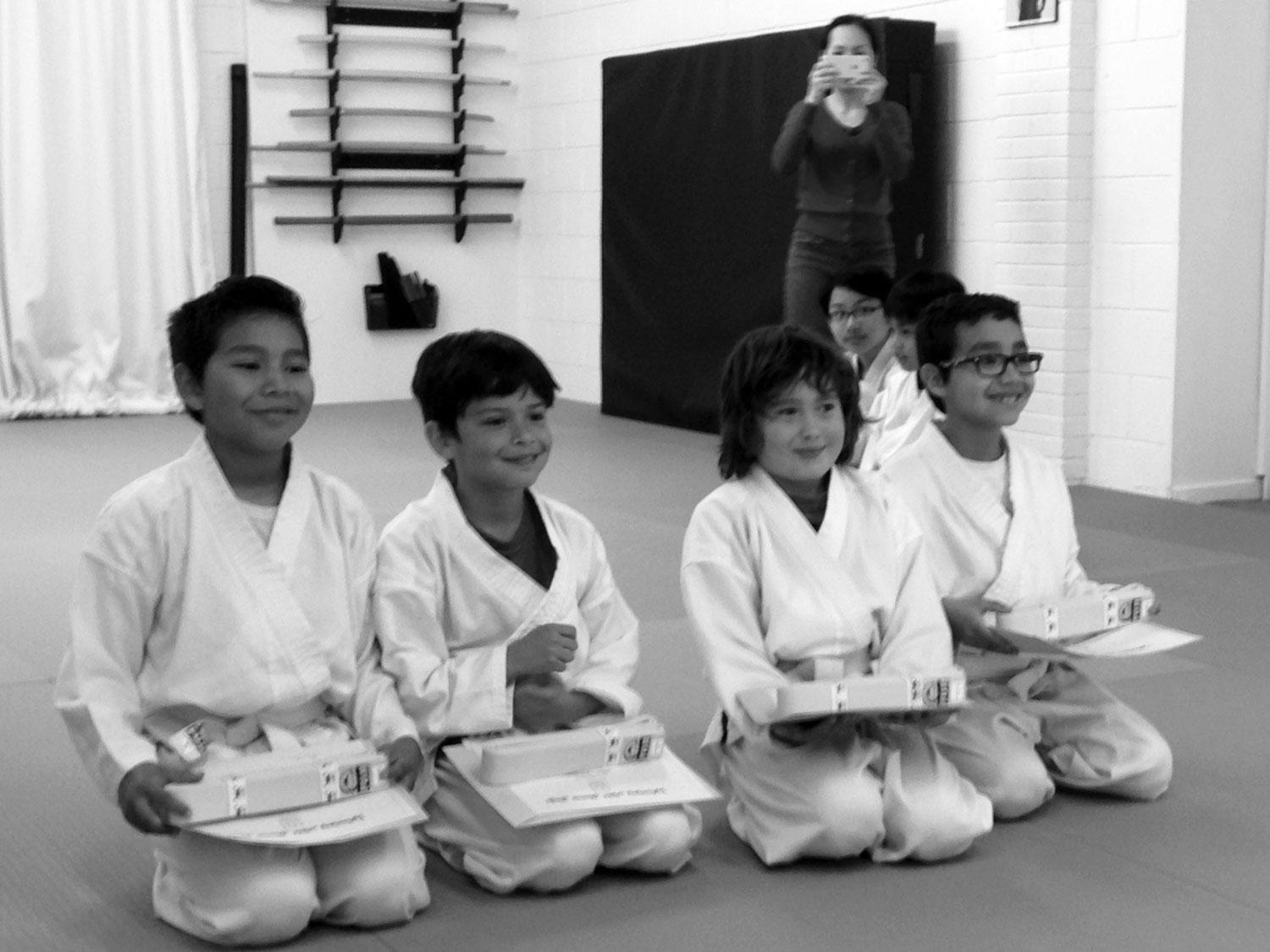 Proud students after completing a successful Kyu test.