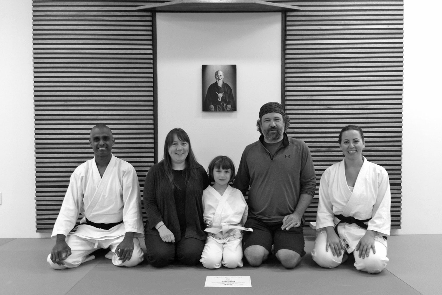 Ruby, her parents and proud Sensei's after successfully completing her Kyu test!