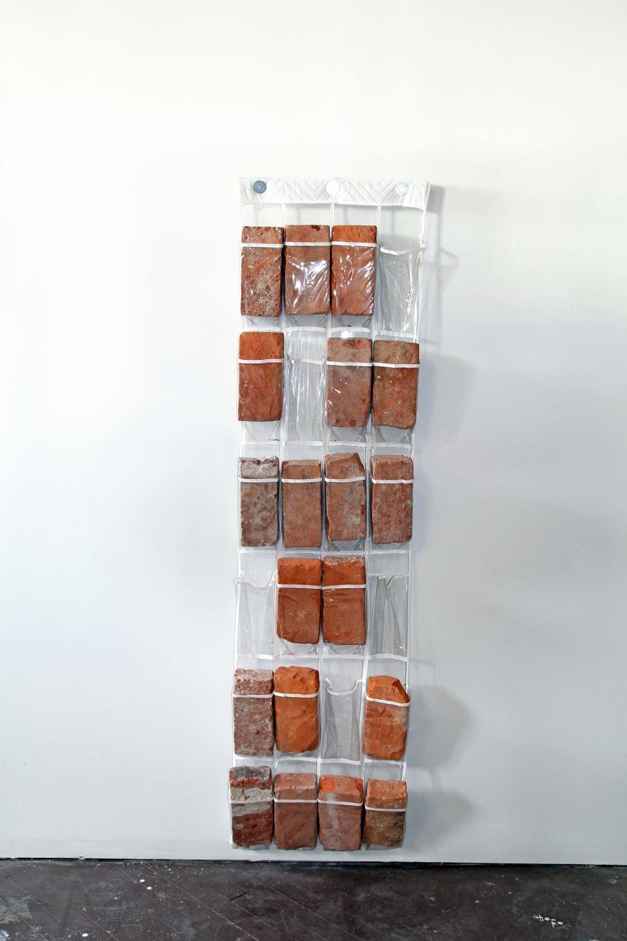 Kasey Toomey   Brick Rack , 2014/2017  Found Bricks, Plastic Shoe Rack, Wood  58x4x16 in.