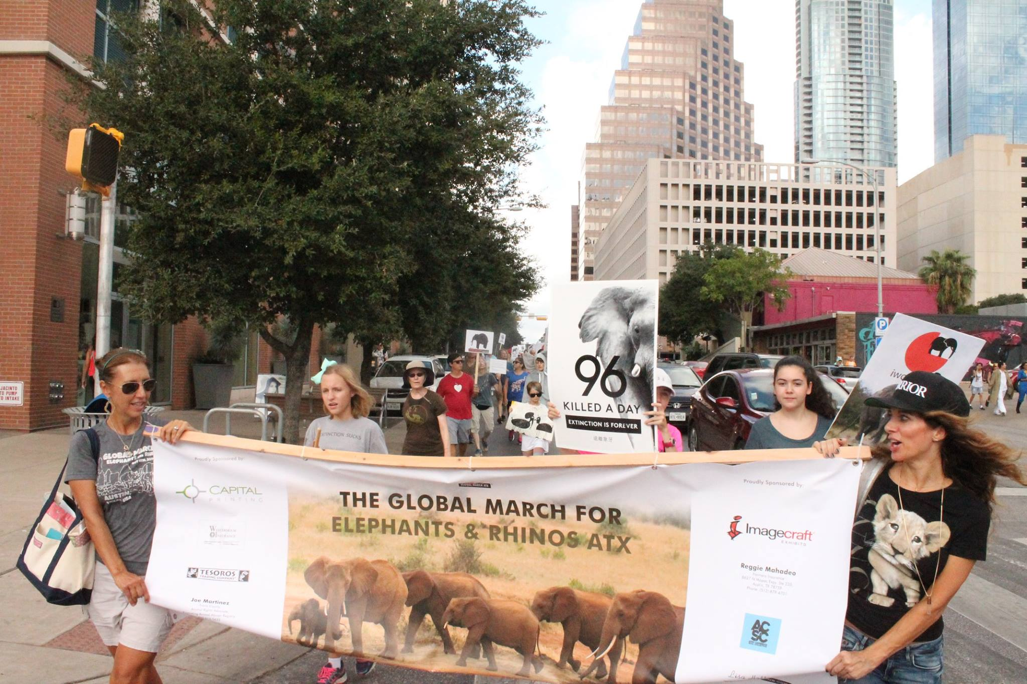 Austin locals marcH in solidarity with the global March for elephants and rhinos INTERNATIONAL in over 140 CITIES WORLDWIDE.