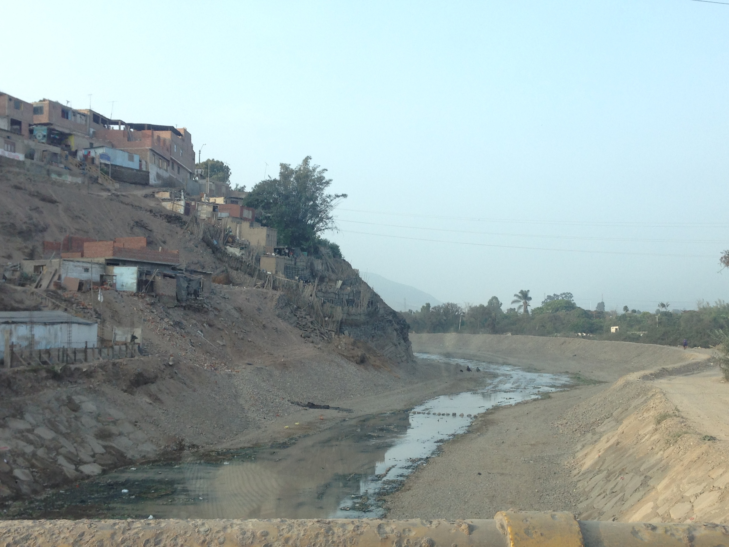Lurin River becoming urbanized by informal development near Pachacamac.