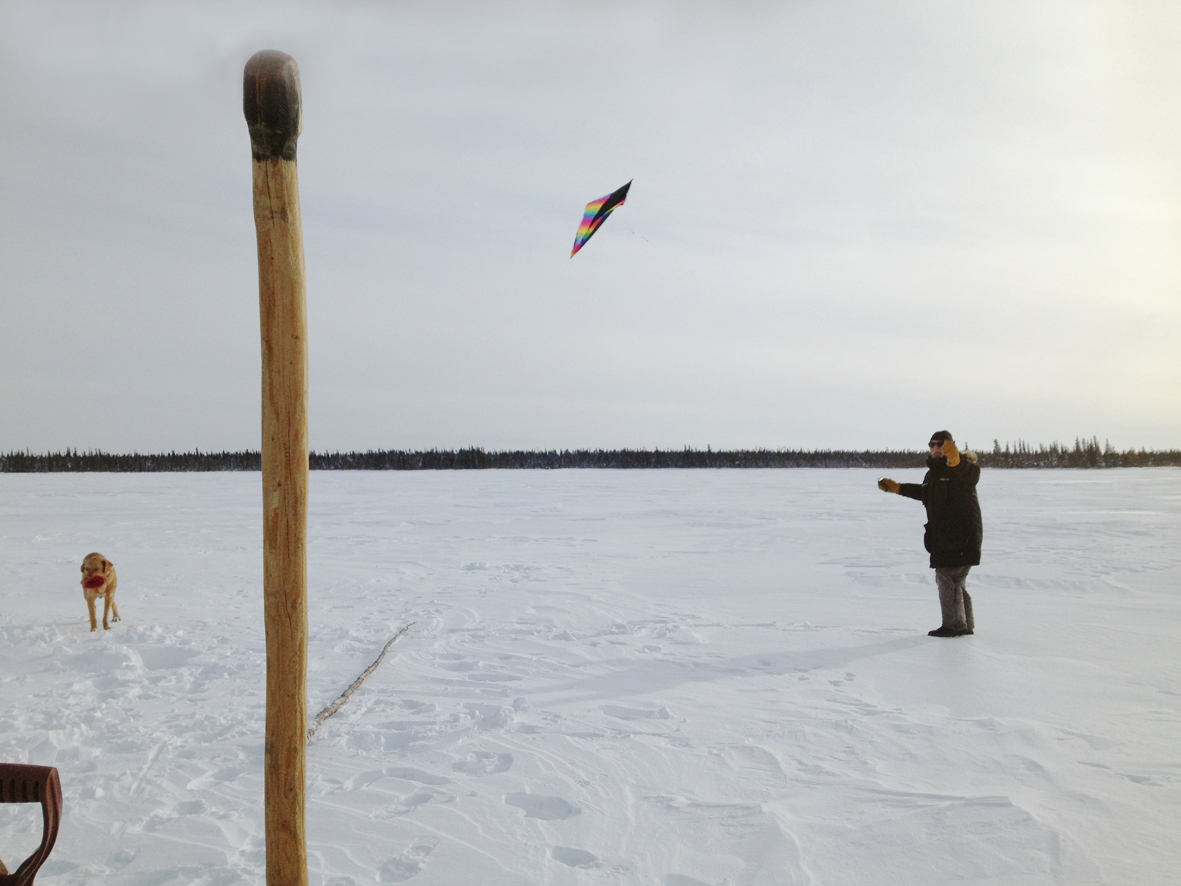 Ice fishing and kite flying on Loon Lake with George.