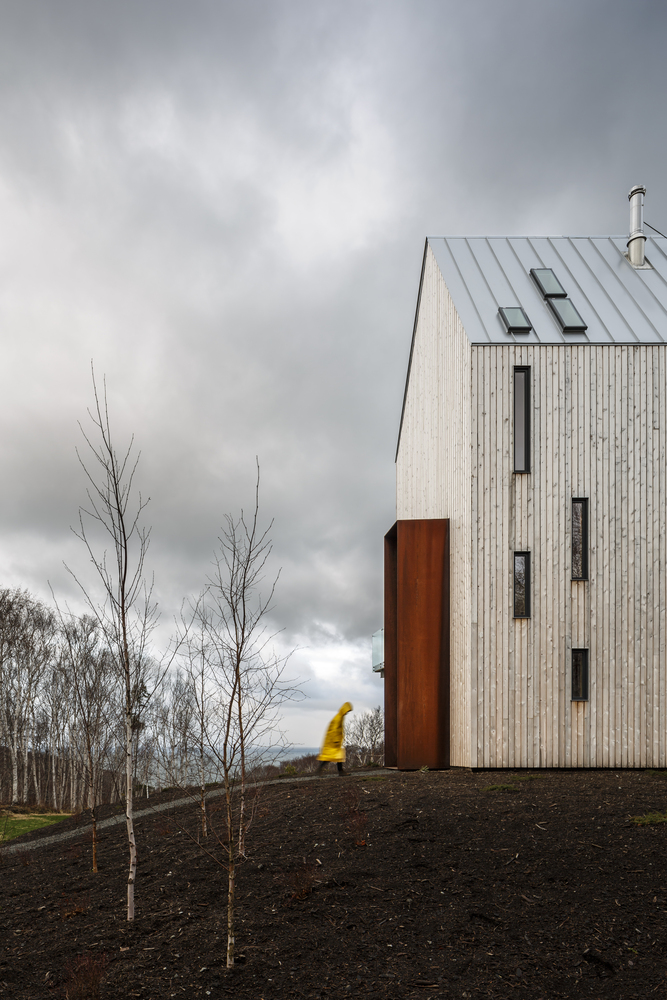 Image 3: The cabin's steel entry hoop takes its shape from the entry windbreaks unique to the Cape Breton and Newfoundland coastal communities. Image by Doublespace.