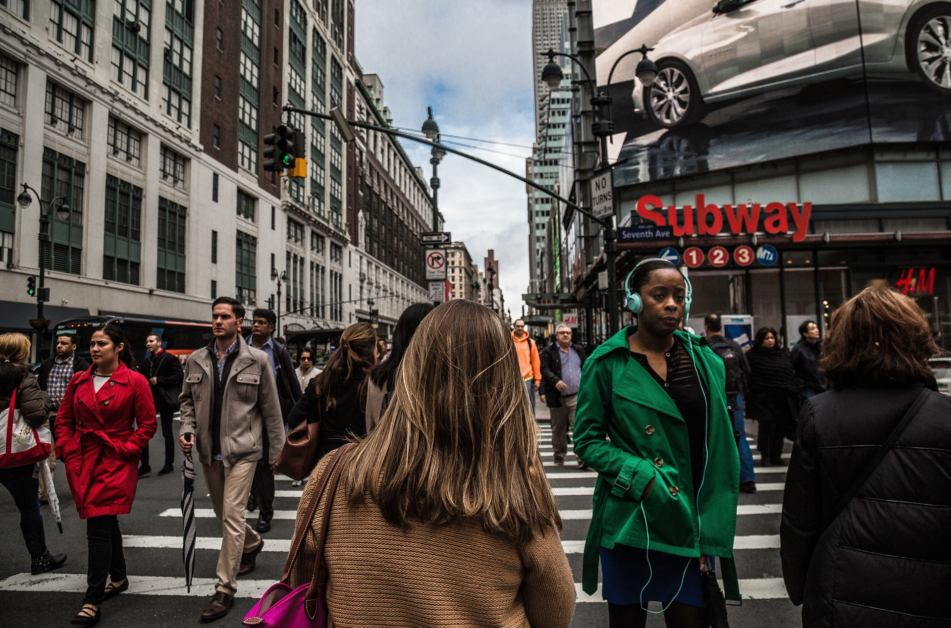 Women cross the street in New York City. Photograph by Christopher Burns ( Unsplash )