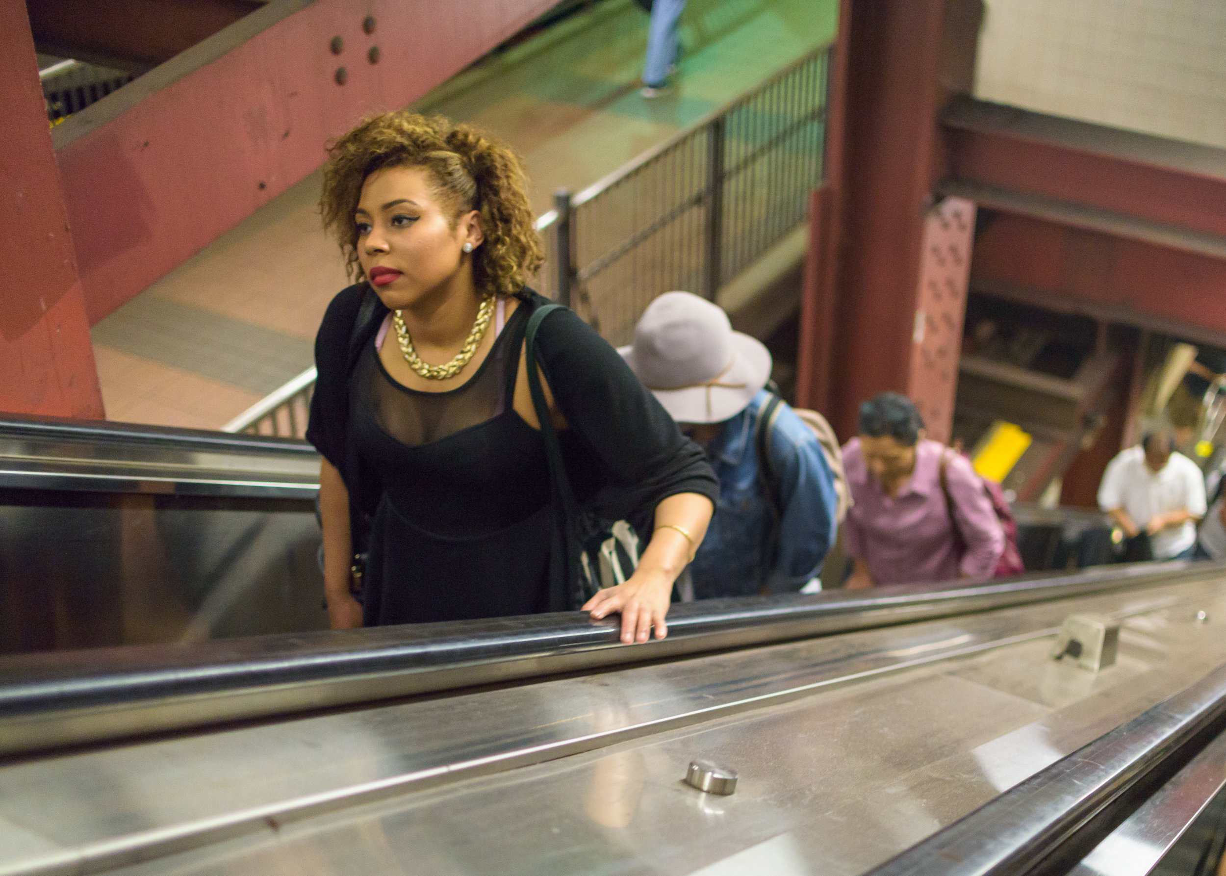 Woman on subway escalator, New York City. Photography by Steven Pisano