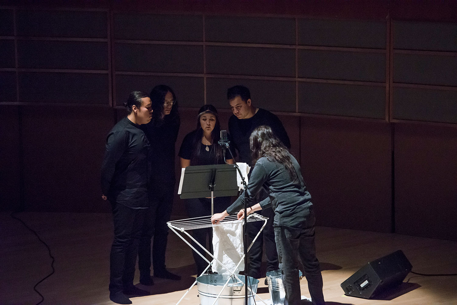 Invited Indigenous, Alberta-based youth musicians, left to right, Curtis Lefthand, seth cardinal, Jaynine Lena McCrae, Marek Tyler, and Cristóbal Martínez (of Postcommodity) perform  in memoriam... Mary Cecil, Victoria Callihoo (née Belcourt), and Eleanor (Helene) Thomas Garneau  at the Francis Winspear Centre for Music in Edmonton, July 18, 2017. Photograph by Kelsey McMillian, Laughing Dog Photography