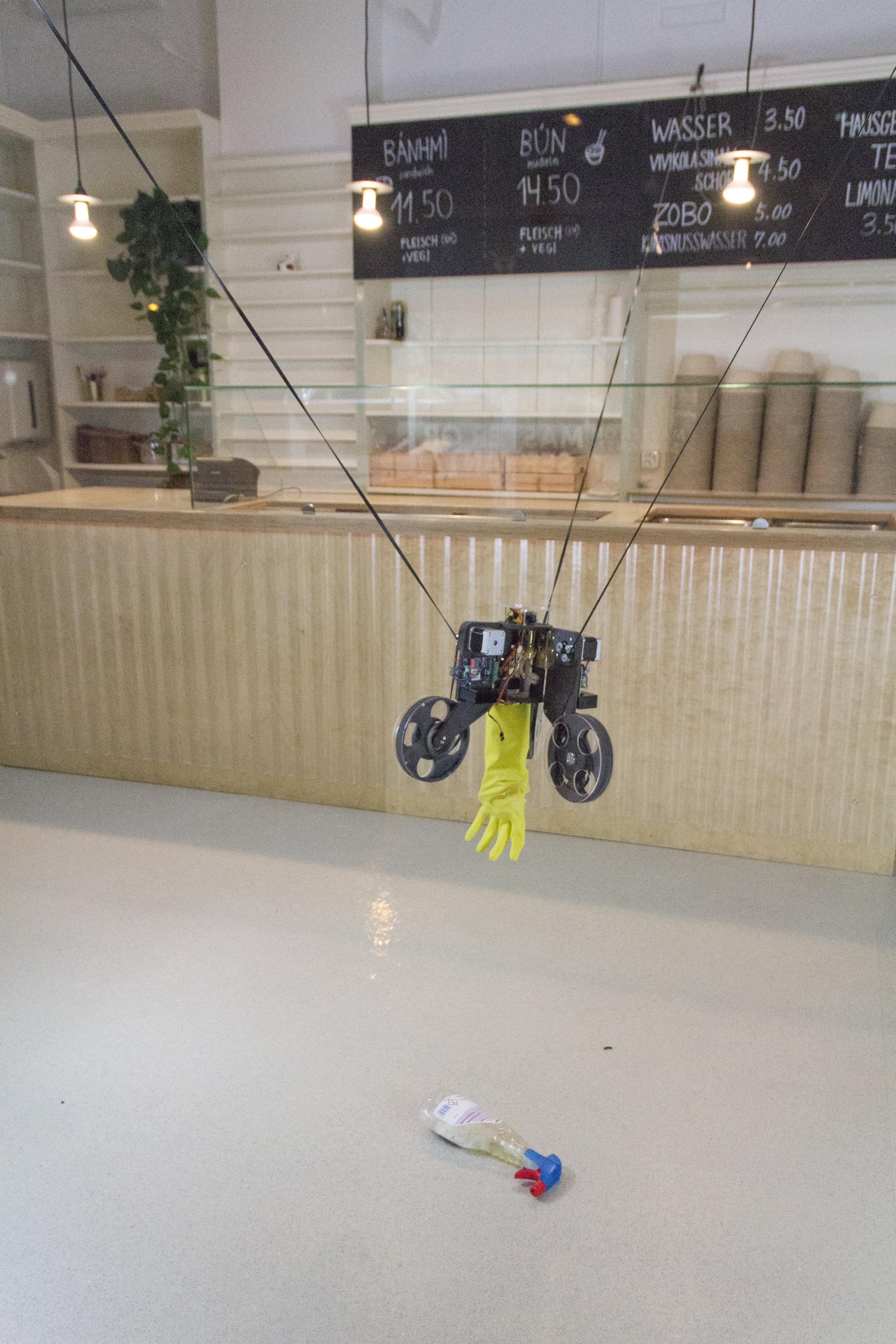 The  Ungenaubot  handling simple tasks in a take away restaurant, 2018. Photograph by Ilmar Hurkxkens and Fabian Bircher