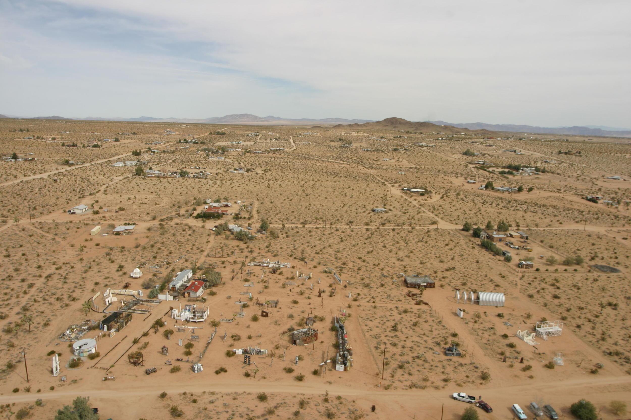 Foreground: Outdoor Desert Art Museum of Assemblage Sculpture | Photo: Low Altitude Blimp Photography | www.lablimp.com
