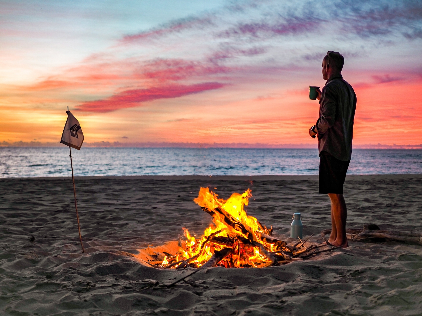 Beach bonfire with our Miir growler filled with mezcal margaritas