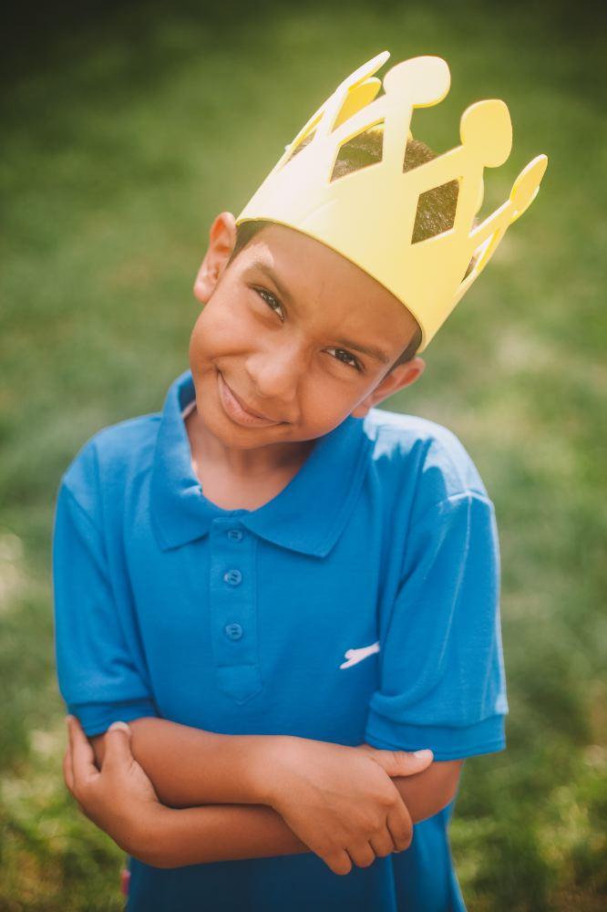 san   diego wedding photographer | kid wearing crown smiling at camera