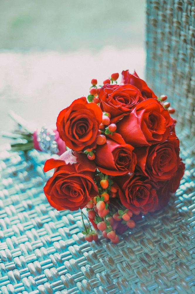 san   diego wedding photographer | red bouquet on woven chair